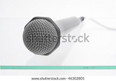 microphone isolated on the glass table
