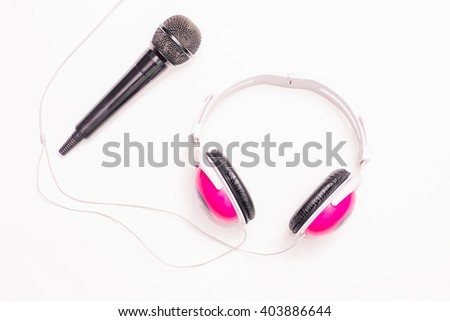 Microphone, mic for audio sound and music. Studio headphone on white background. Musical record on radio. Voice karaoke equipment. Rock, pop broadcast.  - stock photo