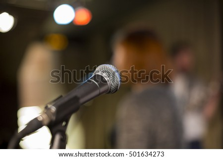 Microphone on a blurred background, the people in the club