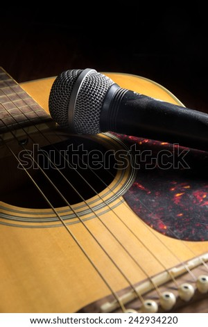 Microphone on acoustic guitar - stock photo