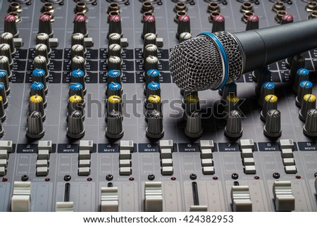 Microphone on mixer board sound knobs