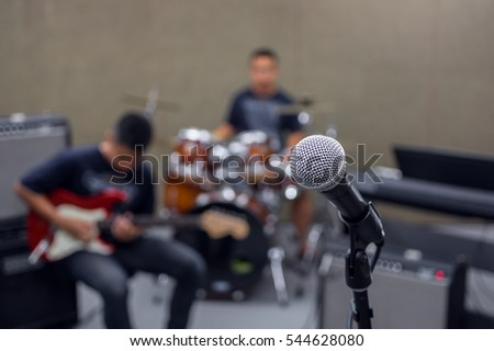 Microphone on musician blurred background, musical concept