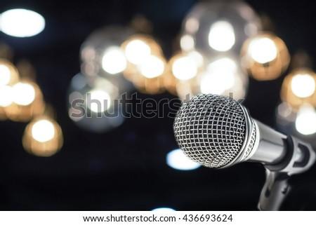 microphone on night bokeh background - stock photo