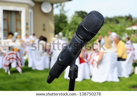 Microphone on the background of the wedding guests. - stock photo