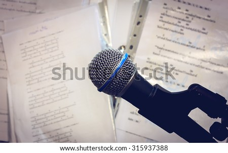 Microphone on the blur lyric background vintage tone and vignetting. - stock photo
