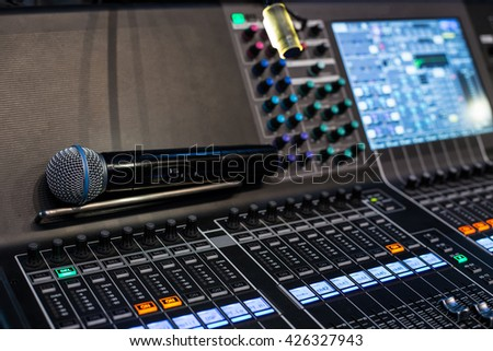 Microphone on the show sound controller - close up photo