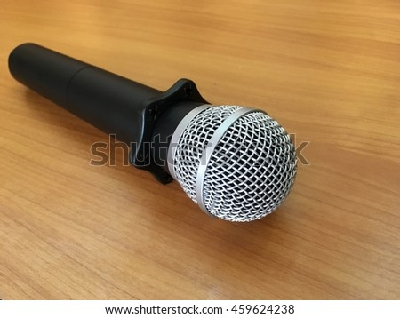 Microphone on wood background