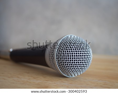 Microphone on wood table.