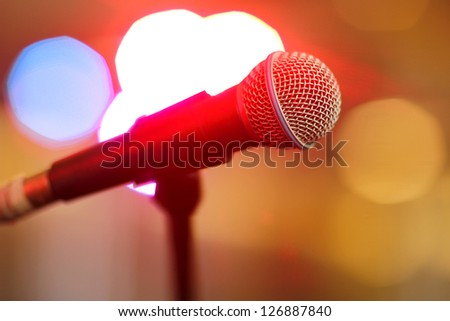 Microphone onstage with bokeh - stock photo