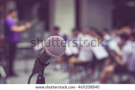 Microphone over the Abstract blurred photo of classic music band when rehearsal, musical and seminar meeting concept