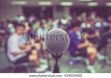 Microphone over the Abstract blurred photo of classic music band when rehearsal, musical concep, seminar meeting concept - stock photo