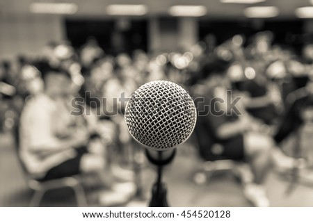 Microphone over the Abstract blurred photo of classic music band when rehearsal, musical concept, seminar meeting concept - stock photo