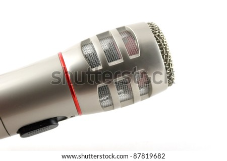 Microphone over white. Shallow DOF. - stock photo