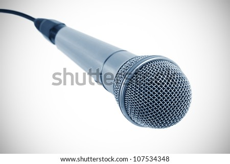 microphone with black wire isolated on white - stock photo