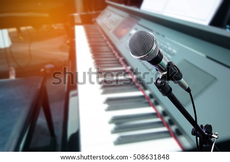 microphone with blurred piano keyboard background