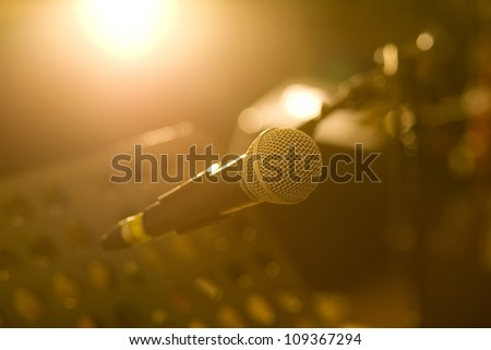 microphone with dramatic light in recording studio - stock photo