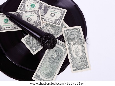 microphone with money on a black background