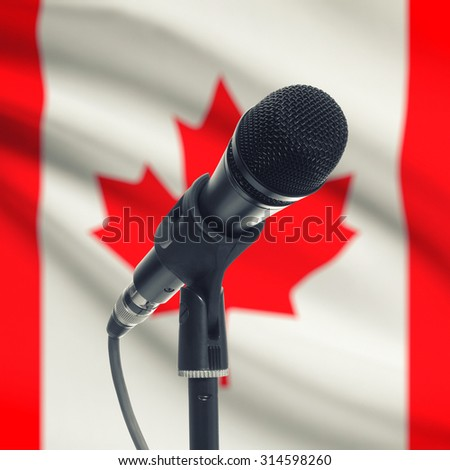 Microphone with national flag on background series - Canada - stock photo