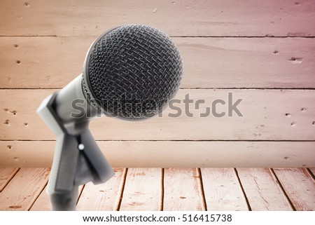 Microphone with stand against a wall