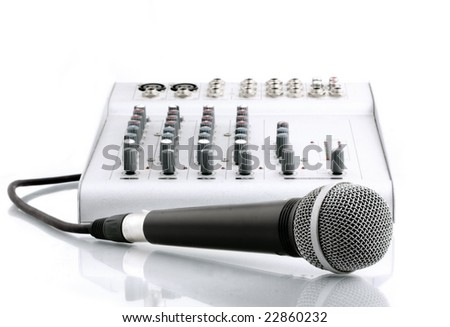 microphone with the mixer in sound studio - stock photo