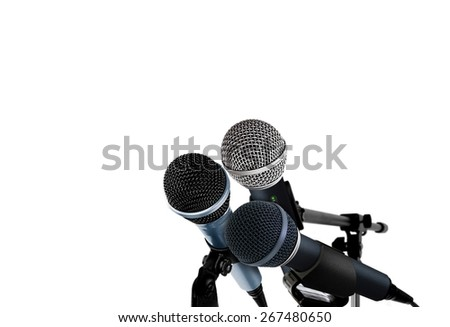 Microphones on white - stock photo