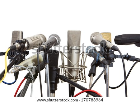Microphones prepared for conference meeting - isolated on white. - stock photo