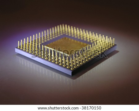 Microprocessor chip in blue light over dark background close up