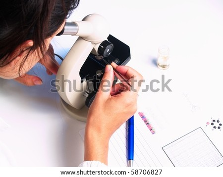 Microscope and doctor on white background