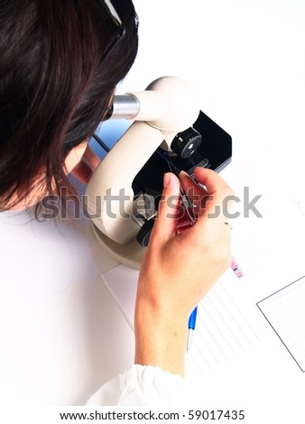 microscope and female doctor on white background - stock photo