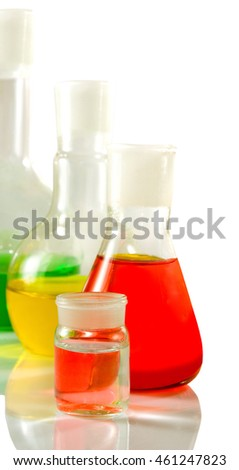 microscope and flasks with liquid in laboratory close up