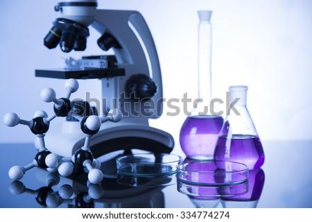 Microscope and laboratory equipment - stock photo