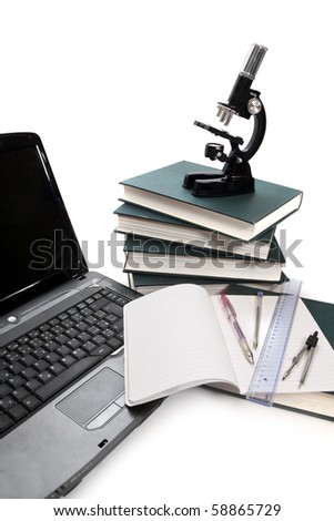 Microscope, books and others tools for for university education.
