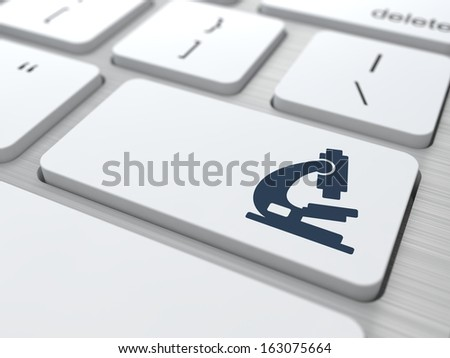 Microscope Icon on Button of White Modern Computer Keyboard. Science Concept. - stock photo
