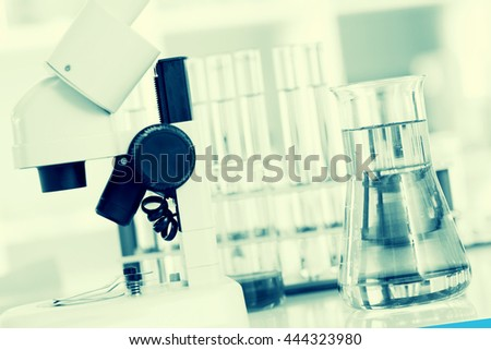 microscope in medical laboratory. Toned image - stock photo