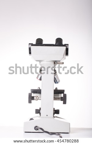 Microscope machine for research experiment with white background.