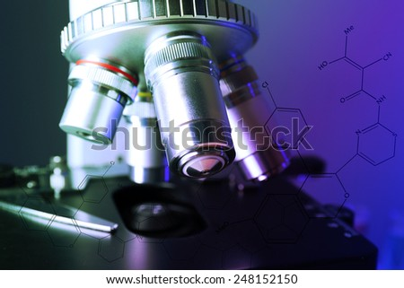 Microscope on color background, close-up - stock photo