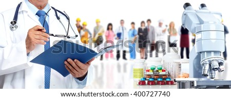 Microscope pills and people group. - stock photo