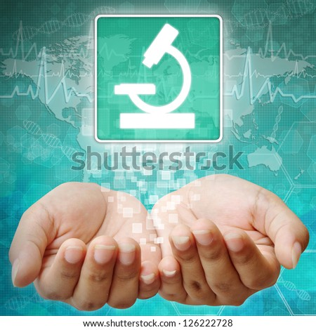 microscope sign on hand ,medical icon - stock photo