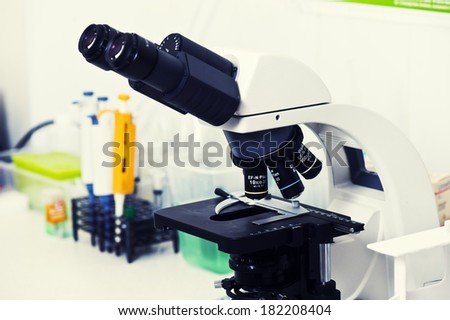 Microscopes in a lab. - stock photo