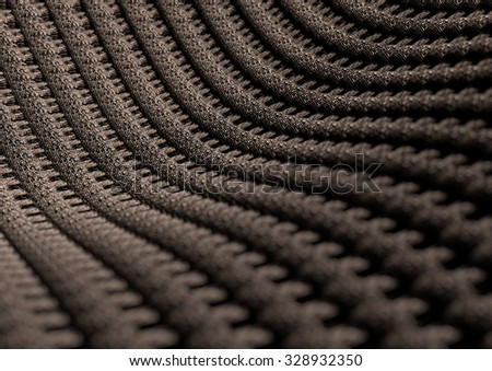 Microscopic close up of blue woven fabric or fibers showing the individual weaves of the cotton or wool fabric. Camera with strong depth of field. Background or texture. - stock photo