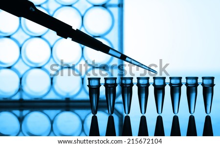 Microtubes and micropipet lab test - stock photo