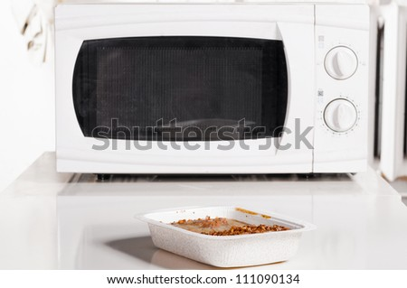 microwave oven with portion of frozen food - stock photo