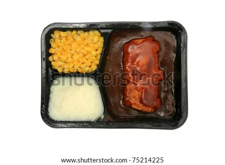 "microwaveable frozen ""tv dinner"" consisting of ""Boneless Pork Rib Shaped Patty Meal"", with ""barbecue sauce and Rib Shaped Patty"" ""mashed potatoes"" and corn, isolated on white with room for your text"
