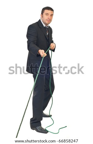Mid adult business man pulling rope isolated on white background - stock photo