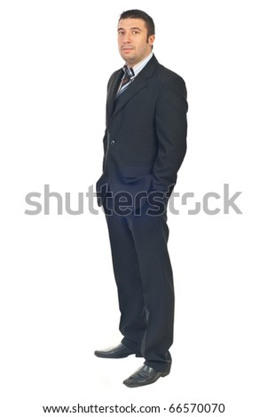 Mid adult business man standing in semi profile with hands in pockets suit isolated on white background