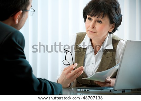 mid-adult businessman in a conversation with the consultant or psychologist