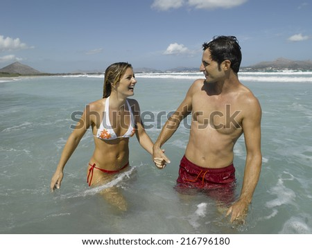 Mid adult couple in the sea