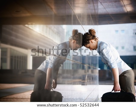 mid adult italian woman banging her head against a wall outside office building. Horizontal shape, copy space