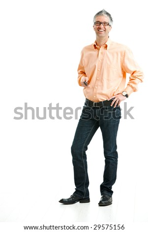Mid-adult man wearing jeans and orange shirt standing and holding mobile phone. Isolated on white.