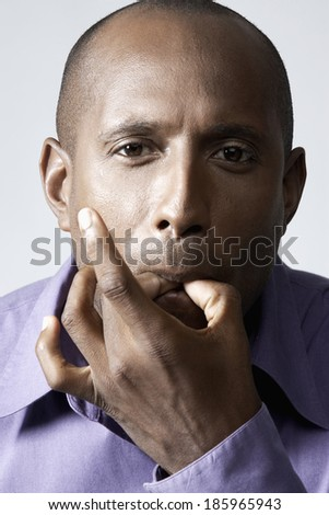 Mid adult man whistling with fingers